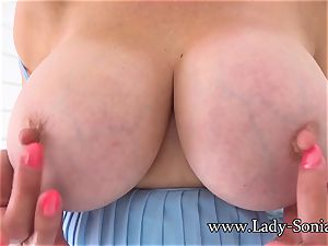 brit mature gal Sonia plays with her hard nips