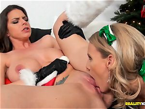 Brianna Ray and Brooklyn pursue decorate the Christmas tree