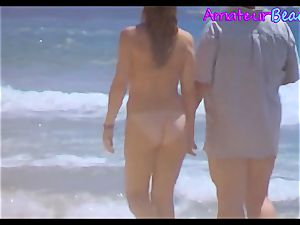 amateur naturist Beach couple walking Along The Beach