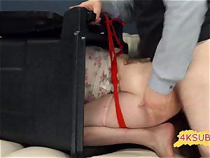 white couch and crimson rope in bondage & discipline