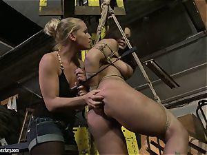 Kathia Nobili spanking the booty of steamy nymph with flog