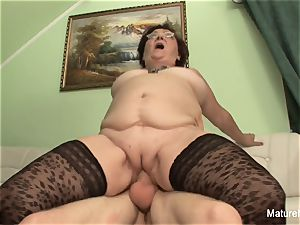 mischievous mature keeps her stockings on for drilling