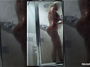 Home video of Nikita Von James taking a shower