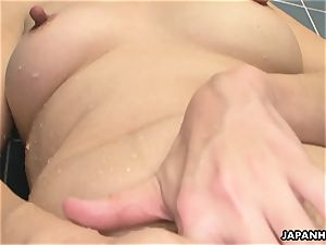 Solo big-boobed japanese bimbo massaging on her moist cooch