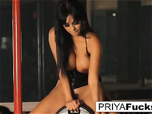 busty Priya Rai rails the sybian saddle at the strip club